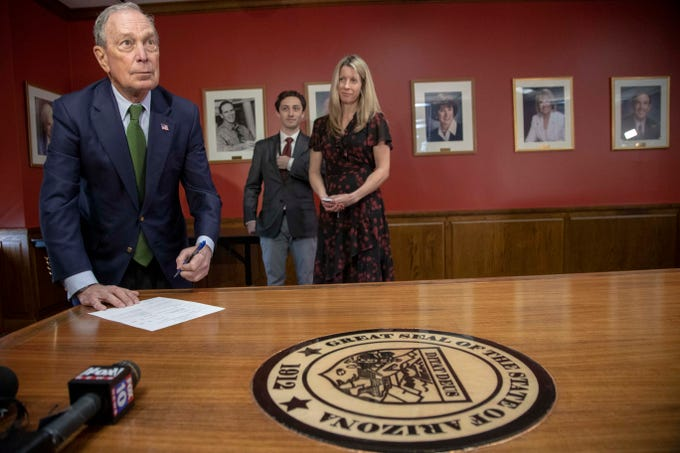Former New York City Mayor and presidential hopeful Michael Bloomberg file paperwork to qualify for the ballot at Arizona Secretary of State's Office on Tuesday, Nov. 26, 2019.