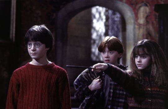 "New Hogwarts students Harry Potter (Daniel Radcliffe, left), Ron Weasley (Rupert Grint) and Hermione Granger (Emma Watson) in ""Harry Potter and the Sorcerer's Stone."""