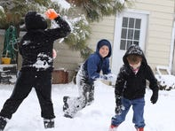 Tuesday's snow called for a snowball fight for the three McKean boys as David, takes aim at his older brother, Ethan Tuesday, Nov. 26, 2019 in  Scottsbluff, Neb.