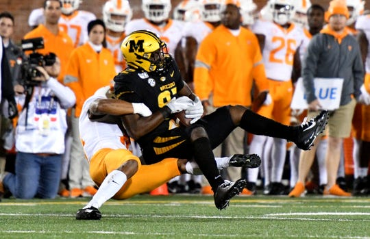 Missouri tight end Daniel Parker Jr. is tackled by Tennessee defensive back Jay Shoop during the first half at Memorial Stadium/Faurot Field.