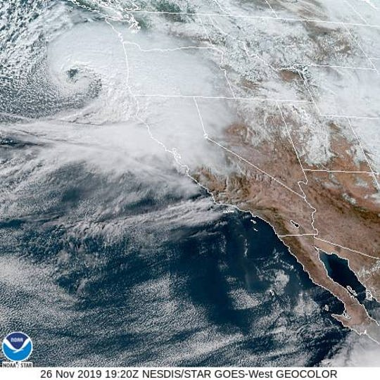 A satellite image shows a bomb cyclone (upper left) gathering strength over the Pacific Ocean as it approaches the Oregon coast on Tuesday, November 26, 2019.