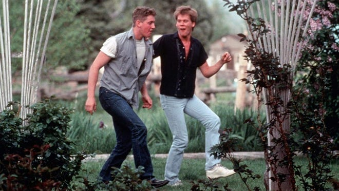 Ren, played by Kevin Bacon, teaches his friend Willard, Christopher Penn, to dance.