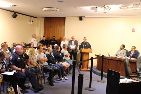 Alexandria Police Department Chief Jerrod King (at podium) speaks Tuesday afternoon before an Alexandria City Council committee about the shortage of officers in his department.