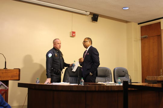 Chief Jerrod King (left) talks with Alexandria Mayor Jeff Hall after a meeting during which the shortage of police officers was discussed. King has been placed on administrative leave for unknown reasons.