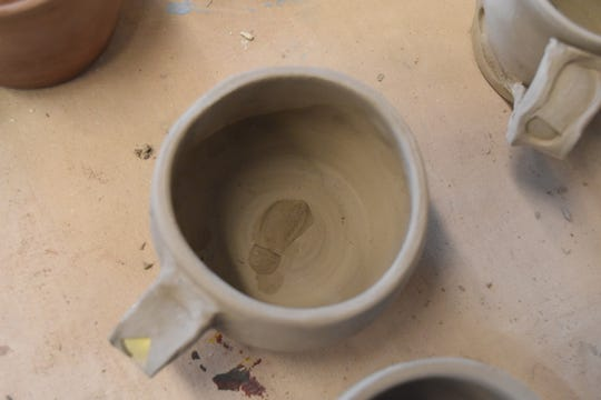 "Each mug will also have imprints of a boot in addition to the trail blazes. ""I got a boot from my daughters' Barbie Doll collection to put a little footprint of a hiker on there,"" said Aubrey Bolen."