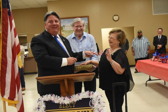 Kyle Ardoin (left), secretary of state for Louisiana, shares a light-hearted moment with Gail Wilking (far right), the newly elected mayor for the Town of Ball, and her husband Chuck Wilking (center), as the oath of office is administered during a ceremony held Tuesday, Nov. 26, 2019 at the Ball Community Center. Gail Wilking is the first woman ever elected mayor of Ball.