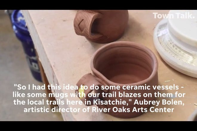 Artist Aubrey Bolen creates mugs with trail blazes of local Kisatchie Forest trails for the annual River Oaks Arts Center Porch Sale.