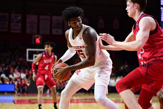 Rutgers' Myles Johnson goes to work on NJIT.