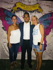 Kelly Terry (left) with Armando Menjivar (center) and Kasey Pickett, co-founder and vice president of the Mya Linn Terry Foundation.