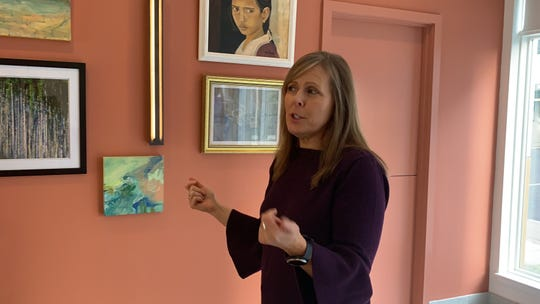 "Connie Isbell, director of memberships and community engagement at Monmouth Arts talks about the ""Out of the Blue"" art exhibit open now at the Bungalow Hotel in Pier Village, on Nov. 21, 2019."