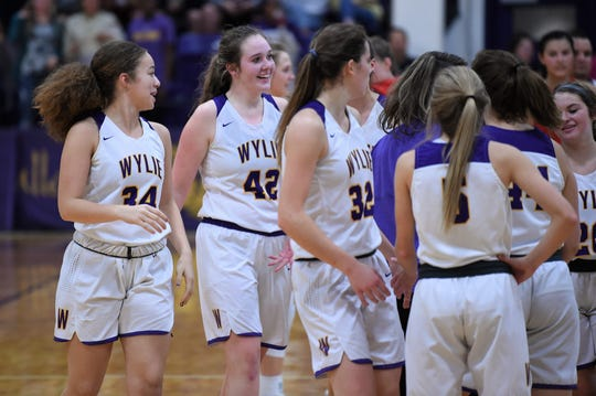Wylie's Bailey Roberts (42) smiles after making the go-ahead shot against Jim Ned with 4.1 seconds left at Bulldog Gym on Tuesday, Nov. 26, 2019. The Roberts led the Lady Bulldogs with 14 points as they pulled out the 42-41 victory in the final seconds.