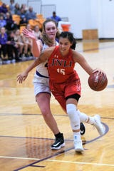 Jim Ned's Alexis Espinosa (15) drives into the lane against Wylie's Bailey Roberts (42) at Bulldog Gym on Tuesday, Nov. 26, 2019. Espinosa scored 12 points, including a late 3-pointer in the 42-41 loss.
