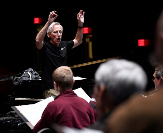 Abilene Philharmonic conductor David Itkin leads the combined choirs of seven churches at a recent rehearsal.
