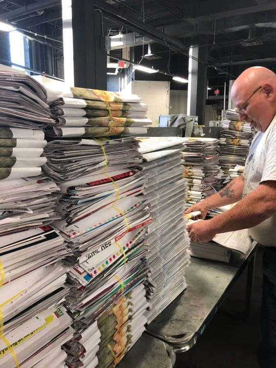 Allen Sprouse, assistant district manager for distribution at the Citizen Times, put together the big Thanksgiving Day paper on Nov. 27, 2019.