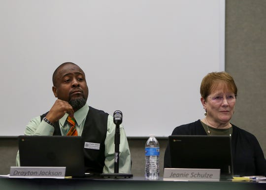 Central Kitsap school board members Drayton Jackson and Jeanie Schulze listen to students and parents who are opposed to changing school start times during the board meeting on Nov. 26.