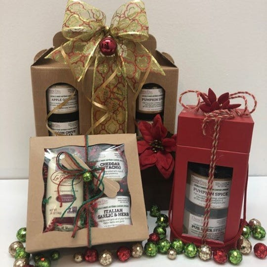 Gift packages of Cheese Etc. & Gourmet Gifts cheese spreads and complementary items.