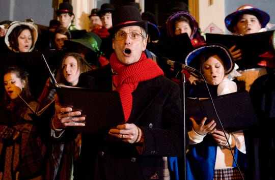 Members of the First Baptist Church of Medford Choir perform during the Dickens Festival in Medford.
