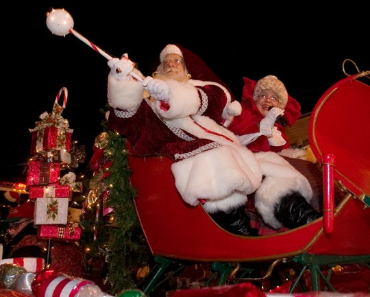 Santa and Mrs. Claus arrive in style during the Maple Shade Parade.