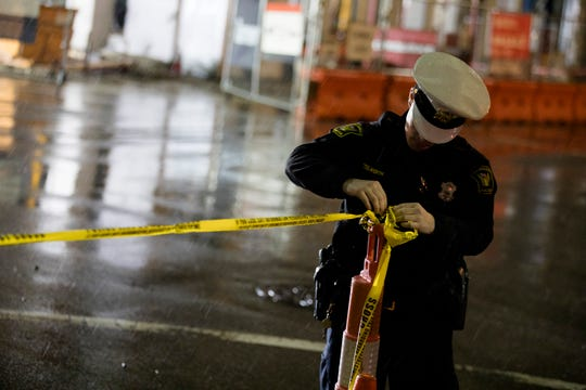 Cincinnati police remove caution tape near the partial building collapse Downtown.
