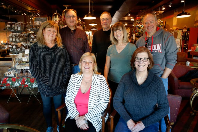 Members of the College Hill Beer Club helped save a park and honor late firefighter Patrick Wolterman. From left to right front row: Janice Redmond, Donna Ebbeler. Back row; Mary Rose, Bob Ebbeler, Doug Kinnett, Kathi Kinnett, and Tim Sexton. Wolterman died almost four years ago rushing into a burning home in Hamilton.