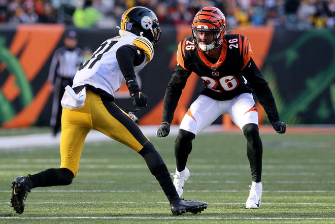 Cincinnati Bengals cornerback Greg Mabin (26) defends against Pittsburgh Steelers tight end Zach Gentry (81) during a special teams play of an NFL Week 12 game, Sunday, Nov. 24, 2019, at Paul Brown Stadium in Cincinnati. The Pittsburgh Steelers won 16-10, and the Cincinnati Bengals fell to 0-11 on the season.