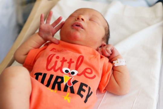 "Baby Vaughn McClimans, son of Randal and Todd McClimans, wearing a ""little turkey"" onesie from The Christ Hospital."