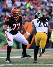 Cincinnati Bengals offensive tackle Cordy Glenn (77) pass blocks against Pittsburgh Steelers inside linebacker Mark Barron (26) in the fourth quarter of an NFL Week 12 game, Sunday, Nov. 24, 2019, at Paul Brown Stadium in Cincinnati. The Pittsburgh Steelers won 16-10, and the Cincinnati Bengals fell to 0-11 on the season.