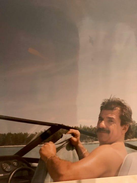Michael Parisi in a boat