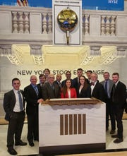 Misericordia University students, faculty and staff toured the New York Stock Exchange. Participating in the Future Business Leaders of America – Phi Beta Lambda program, first row from left, are Patrick Rother, Mountain Top, Pennsylvania.; Kevin Feifer, director, Office of Service Learning; Ata Yesilyaprak, Ph.D., associate professor, business; Jayme DeMedio, Collegeville, Pennsylvania.; president, BPA/PBL; Alexa Monro, Kinnelon, treasurer, BPA/BPL; Charles J. Makar, M.B.A., instructor, business, and Max Gariano, Mountain Top, Pennsylvania.; second row, Matthew Foss, Old Forge, Pennsylvania., secretary, BPA/PBL; Lena Eldrenkamp, Old Bridge, Charles Richardson, Ph.D., dean, College of Business; Jose Gonzalez, Collegeville, Pennsylvania, historian, BPA/PBL; Matthew Jennings, Bridgewater, vice president, BPA/BPL; Thomas Weiskircher, Huntingtown, Maryland., activities coordinator, BPA/PBL, and Joseph Donahue, corporate relations coordinator, Insalaco Center for Career Development.