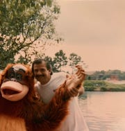 Michael Parisi with a costumed character
