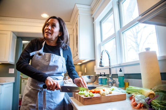 Sen. Kamala Harris, D-Calif. takes questions as she begins preparing a Thanksgiving meal at a home in Des Moines Wednesday, Nov. 27, 2019.