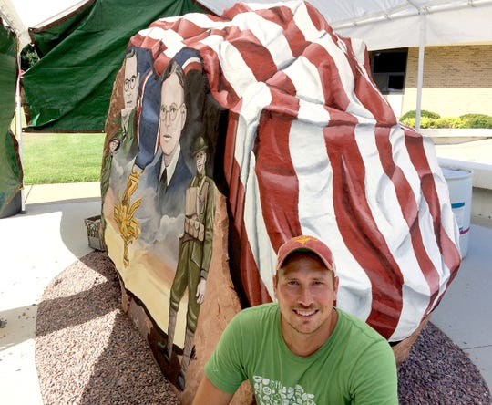 """Artist Ray """"Bubba"""" Sorensen II is shown at the Cherokee County Freedom Rock outside the Cherokee County Courthouse in Cherokee, Iowa, in this July 26, 2017, photo."""