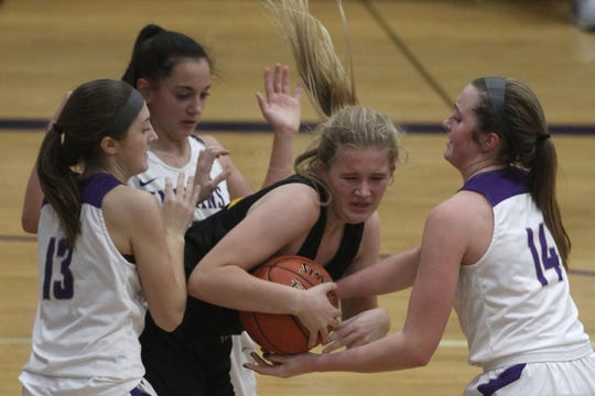 Indianola freshmen Brynn Ortlund and Emily Naughton and sophomore Lauren Blake surround Southeast Polk sophomore Brooke Woodyard. Indianola fell 83-50 to Class 5A sixth-ranked Southeast Polk in the home-opener in Indianola on Nov. 26.