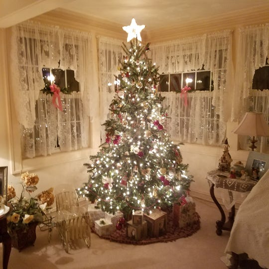Kathleen and Glenn Zubok, of Dearborn, will show off their Christmas tree and other decorations at the Ford Homes Historic District holiday home tour Dec. 8.