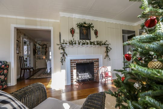 The original fireplace in the living room of the home of Nolan and Susan Clark in the Ford Homes Historic District in Dearborn, Mich., photographed on Tuesday, Nov. 26, 2019.