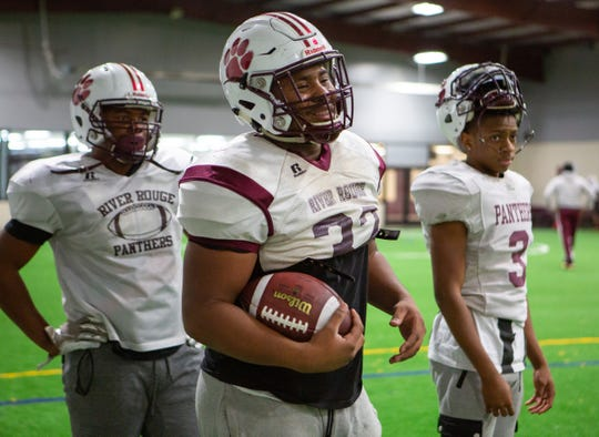 River Rouge running back De'Andre Bulley laughs with teammates during practice drills in Melvindale, Tuesday, Nov. 26, 2019.