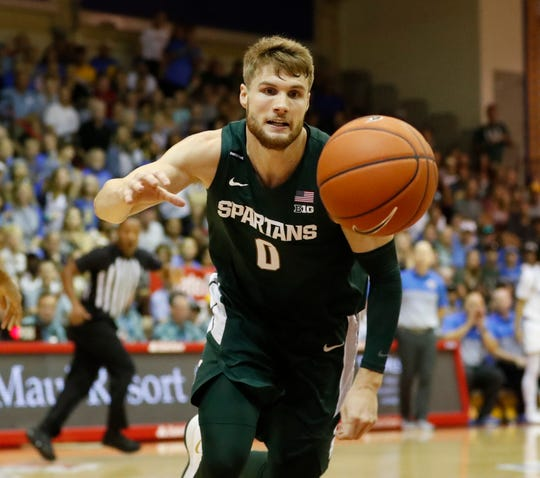 Michigan State guard Kyle Ahrens chases down a loose ball during the first half on Wednesday, Nov. 27, 2019, in Lahaina, Hawaii.