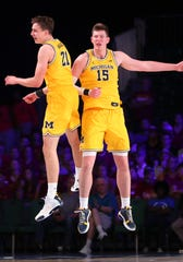 Franz Wagner, left, and Jon Teske celebrate during the second half of Michigan's 83-76 win over Iowa State in the Battle 4 Atlantis tournament on Wednesday, Nov. 27, 2019, in Paradise Island, Bahamas.
