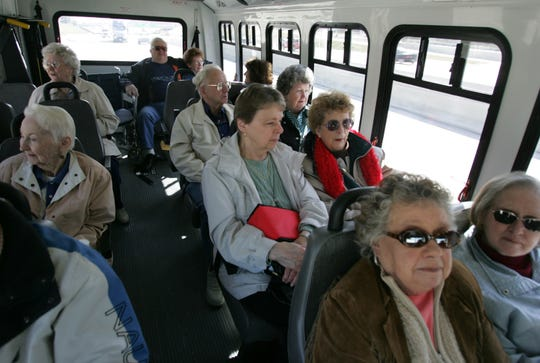 This photo from the mid-2000s shows a group of Westland seniors on a bus to Canada to buy cheaper prescription drugs.