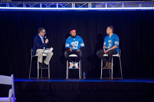 Dan Miller talks with cornerback Jamal Agnew (39) and punter Sam Martin (6) at the Detroit Lions draft party during Round 2, April 26, 2019 in Allen Park.