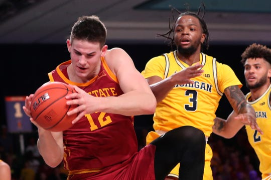 Iowa State forward Michael Jacobson grabs the ball away from Michigan guard Zavier Simpson during the first half of the Battle 4 Atlantis game on Wednesday, Nov. 27, 2019, at Imperial Arena.