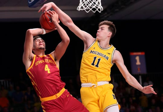Michigan forward Colin Castleton blocks the shot of Iowa State forward George Conditt IV during the first half of the Battle 4 Atlantis game on Wednesday, Nov. 27, 2019, at Imperial Arena.