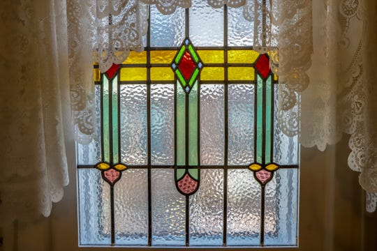 Nolan and Susan Clark added a stained glass window in the foyer of their historic Ford home in Dearborn, Mich. for a wedding anniversary photographed on Tuesday, Nov. 26, 2019.