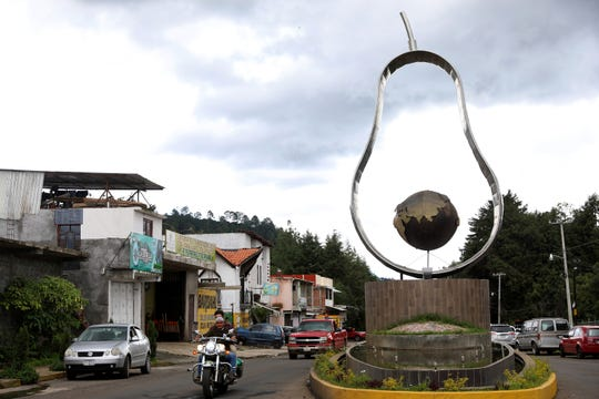 A sculpture of an avocado in Tancitaro, Michoacan, on Aug. 24, 2019. The entrance to Tancitaro, a population of roughly 30,000, claims it is the Avocado Capital of the World. Mexican cartels have evolved beyond drug trafficking; extortion and theft of the local avocado and timber industries