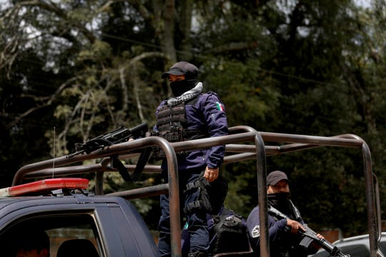 CUSEPT, an armed avocado police force, is a private security force funded by avocado growers, on patrol in Tancitaro, Michoacan, on Aug. 24, 2019. The entrance to Tancitaro, a population of roughly 30,000, claims it is the Avocado Capital of the World.
