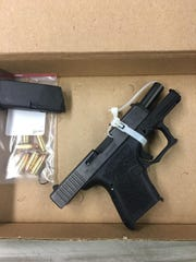 """Police seized this gun, which is referred to as a """"ghost gun,"""" in November. It was assembled via parts ordered online and didn't have a serial number, police said."""