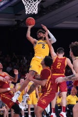 Michigan forward Isaiah Livers (2) drives to the basket during Wednesday's win over Iowa State.