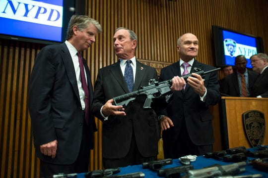 File-This photo from Friday, Oct. 12, 2012, shows District Attorney Cyrus Vance, left, Mayor Michael Bloomberg, center, NYPD Police Commissioner Ray Kelly, right, with confiscated illegal firearm during a press conference in New York.