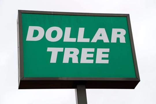 A large billboard sign is displayed at a Dollar Tree store in Richland, Miss., Tuesday, Nov. 26, 2019.