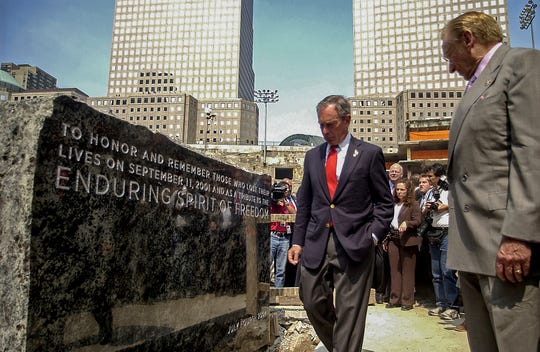 File-This photo from Sunday, July, 4, 2004, shows developer Larry Silverstein, right, and New York Mayor Michael Bloomberg at the unveiling of a 9-foot-by-4-foot granite cornerstone, after it was lifted into its resting spot at the World Trade Center site in New York.